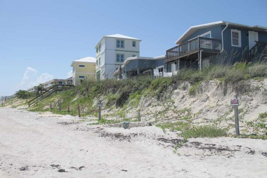 In Satellite Beach homes perch atop a sand dune, left exposed after a series of storms and hurricanes washed away a sea wall (April 2019)