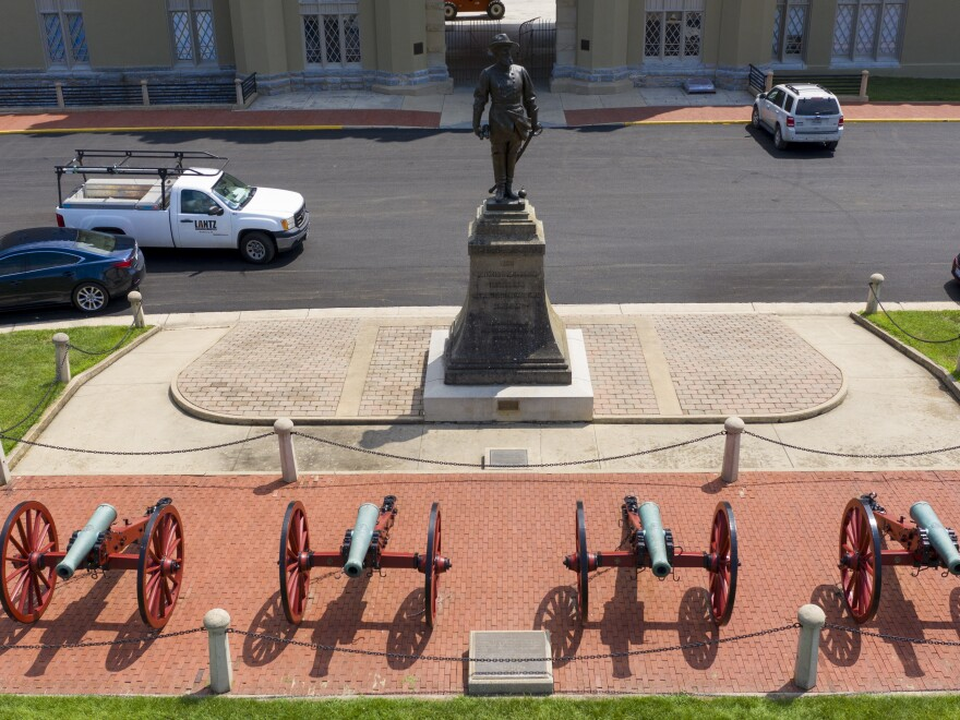 A statue of Confederate General Stonewall Jackson stands behind cannons at the entrance to the barracks at Virginia Military Institute in this July photo. Superintendent J.H. Binford Peay III resigned on Monday amid allegations that the school's culture was hostile to Black cadets.