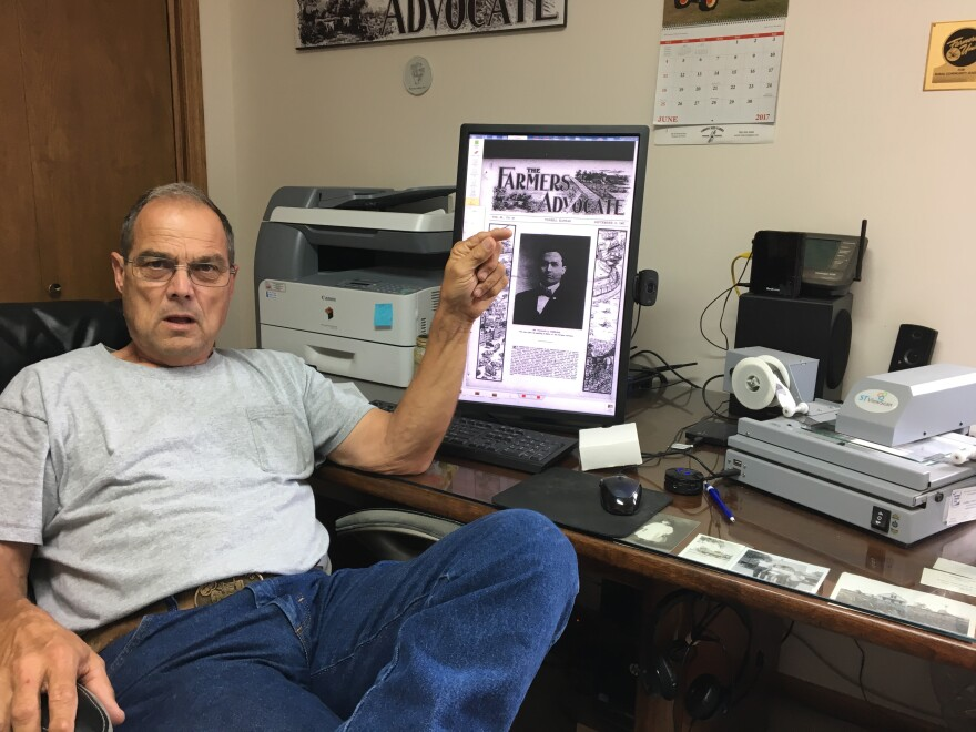 Giessel sits in his office next to his computerized microfilm reader. He is the unofficial historian of the Kansas Farmers Union.