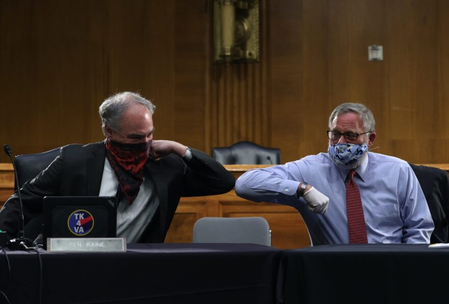 US Senators Tim Kaine (D-VA) and Richard Burr (R-NC) greet each other with an elbow bump before the Senate Committee for Health, Education, Labor, and Pensions hearing to examine COVID-19 and Safely Getting Back to Work and Back to School in Washington, DC.