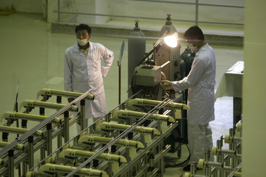 Iranian technicians work at a nuclear facility near Isfahan in 2009. Iran reached an interim deal with world powers in January of this year, and current talks in Vienna are aimed at producing a comprehensive agreement.