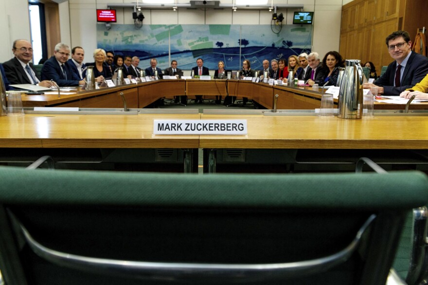 """The International Grand Committee with representation from 9 Parliaments and Mark Zuckerberg in non-attendance. Lawmakers from nine countries grilled Facebook executive, Richard Allan, on Tuesday as part of an international hearing at Britain's parliament on disinformation and """"fake news."""" Facebook's vice president for policy solutions, answered questions in place of his boss, CEO Mark Zuckerberg, who ignored repeated requests to appear. (Gabriel Sainhas/House of Commons via AP)"""