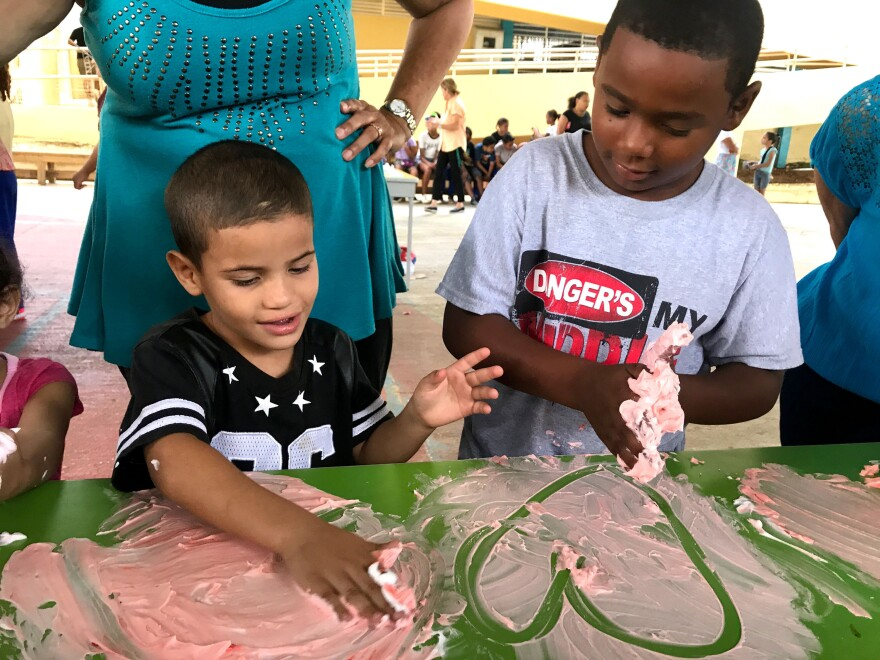 Hearts are popular with the kindergarteners, while third-graders finger painted more houses.