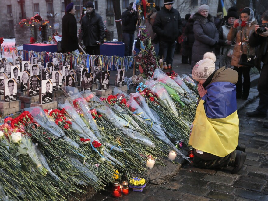 """People pay their respects Friday in honor of the """"Heavenly Hundred"""" who were killed a year ago on Independence Square in Kiev, Ukraine."""