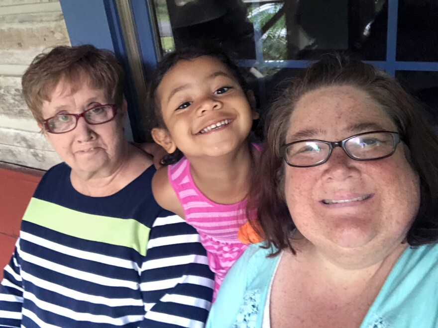 Maxine Edwards (left) has been taking care of her granddaughter Kinsley at home since the pandemic closed the child's preschool. Kinsley's mom, Kristi Edwards (right), continues to work as a patient coordinator at a hearing center.