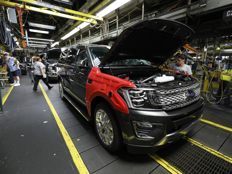 A 2018 Ford Expedition goes through the assembly line at a Ford plant Oct. 27, in Louisville, Ky. Higher-profit SUVs and trucks are making up a larger share of auto sales, boosting the industry's fortunes.