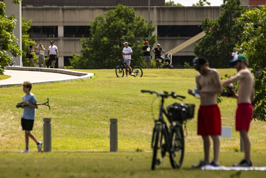 People walk and ride bikes near Auditorium Shores and the Long Center on April 13.