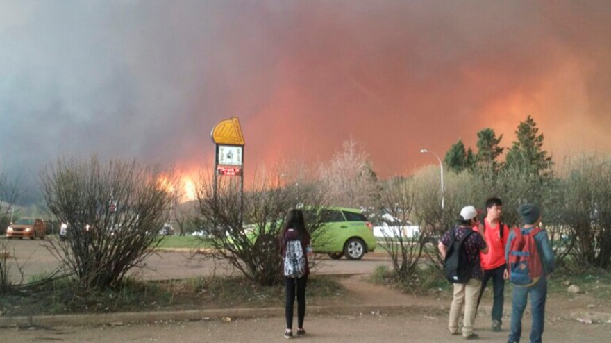 Students from Fort McMurray Composite High School are released early as wildfire burns nearby in Fort McMurray, Alberta, Canada on Tuesday. An uncontrolled wildfire burning near Fort McMurray in northern Alberta, the heart of Canada's oil sands region, has forced the evacuation of nearly all the city's 80,000 residents, local authorities said on Tuesday.