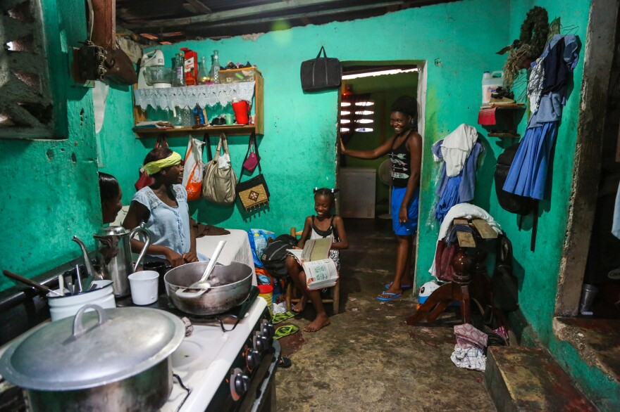 In a hillside neighborhood above downtown Port-au-Prince, Desir's cousin Daniele Joseph lives in a three-room house. Her husband, son and four of her sisters, all Desir's relatives, live in the home.
