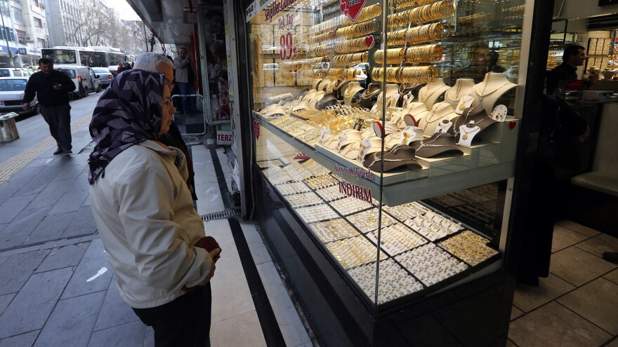Shoppers gaze at a jewelry store display window in the Turkish capital Ankara on Feb. 19. Some economists have coined the term MINT to include the up-and-coming emerging markets of Mexico, Indonesia, Nigeria and Turkey. But Turkey has been hit by street protests, and others in the group have had their share of recent turbulence.