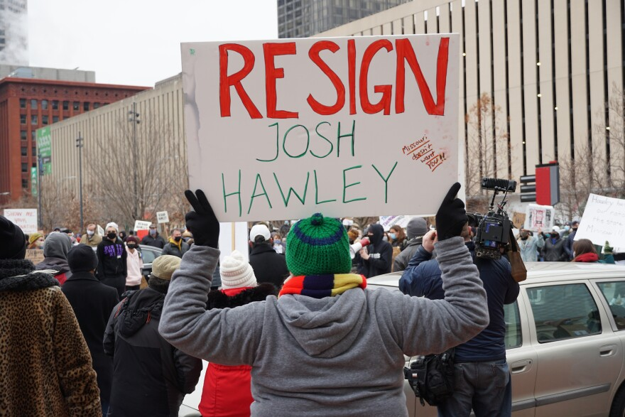 """Protesters waved signs and chanted """"You don't even live here"""" during Saturday's rally, a reference to the fact that Sen. Hawley primarily resides in the suburbs of Washington, D.C."""
