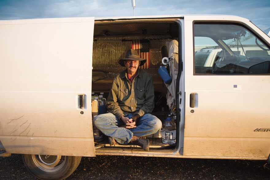 """A vandweller known as """"Ghost Dancer"""" sits in the vehicle he calls home. (Jessica Bruder)"""