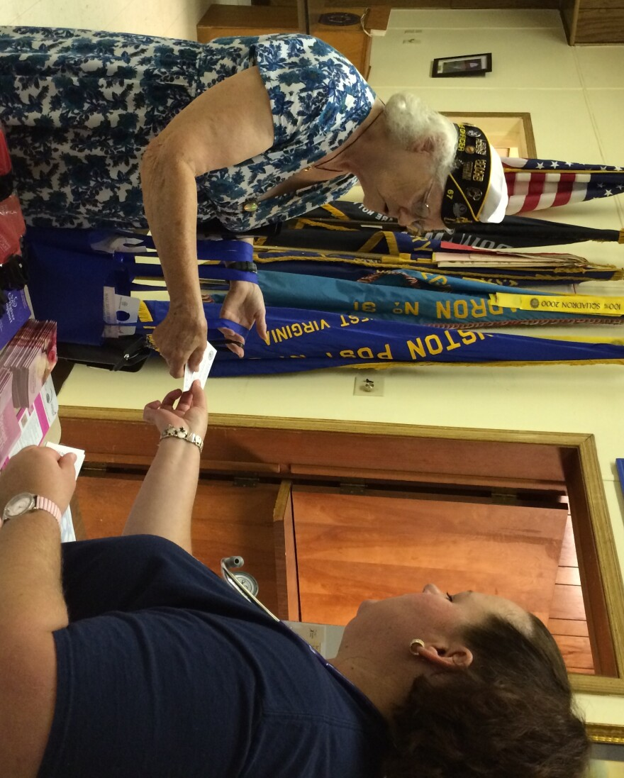 Donna Peter, Service Officer for American Legion Post 67 and the 4th District receives information from Heather Zickefoose, LPN with the VA's Mobile Health Unit.