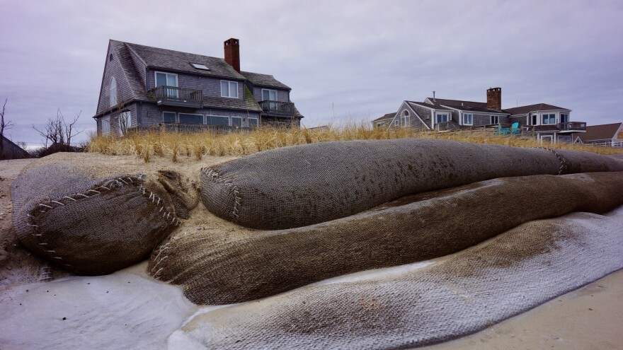 Uncovered fiber rolls in front of a private home on Town Neck Beach in Sandwich, Mass. Made from coconut fiber and filled with sand, they are designed to prevent beach erosion.