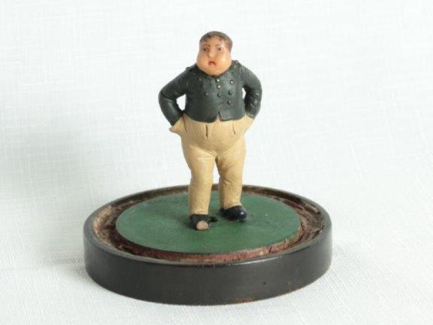 "A sculpture of ""Fat Boy Joe,"" a character from Dickens' <em>Pickwick Papers.</em>"
