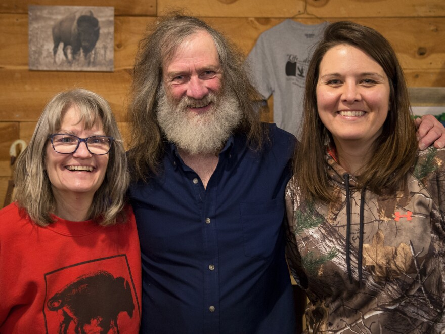 Little Swan Lake Winery owners Diane and Scott Benjamin (left and center) pose for a picture with neighbor Erica Schultes (right) near Estherville, Iowa, on Jan. 23, 2018.