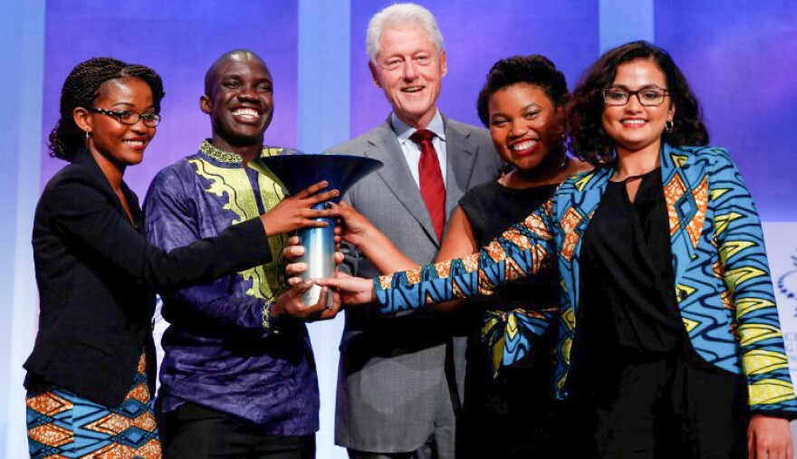 Team Magic Bus, from Indiana's Earlham College, poses with former President Bill Clinton after winning the $1 million Hult Prize. From left: Leslie Ossete, Wyclife Omondi, Iman Cooper and Sonia Kabra.