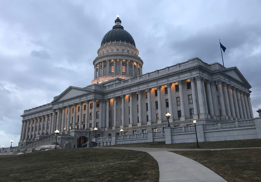 A photo of the Utah State Capitol at night.