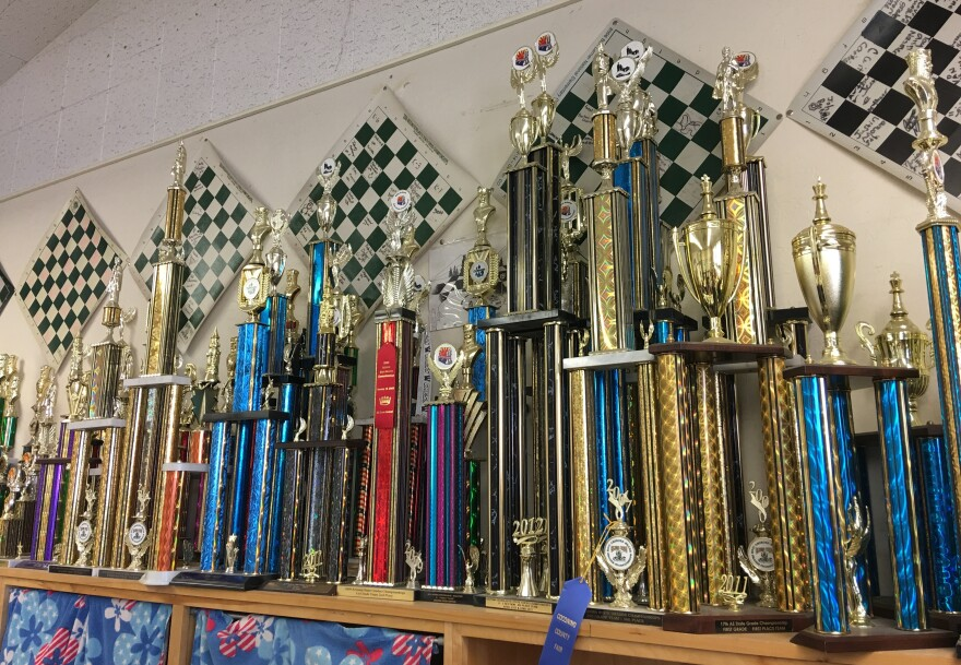 Trophies from past chess tournaments line the wall at Killip Elementary.