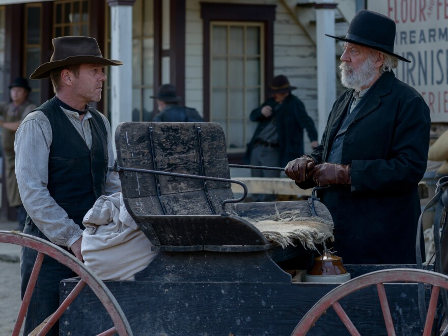 Kiefer Sutherland (left) as John Henry Clayton and Donald Sutherland (right) as Reverend William Clayton in the western <em>Forsaken</em>.