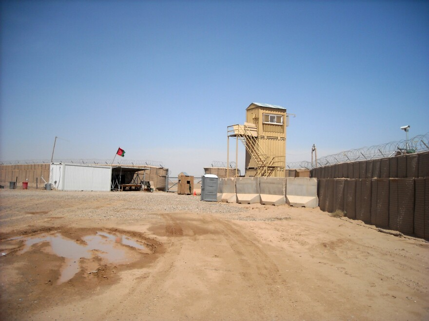 An Afghan military base, left, and an American military base at Camp Garmser, Helmand province, in southern Afghanistan.