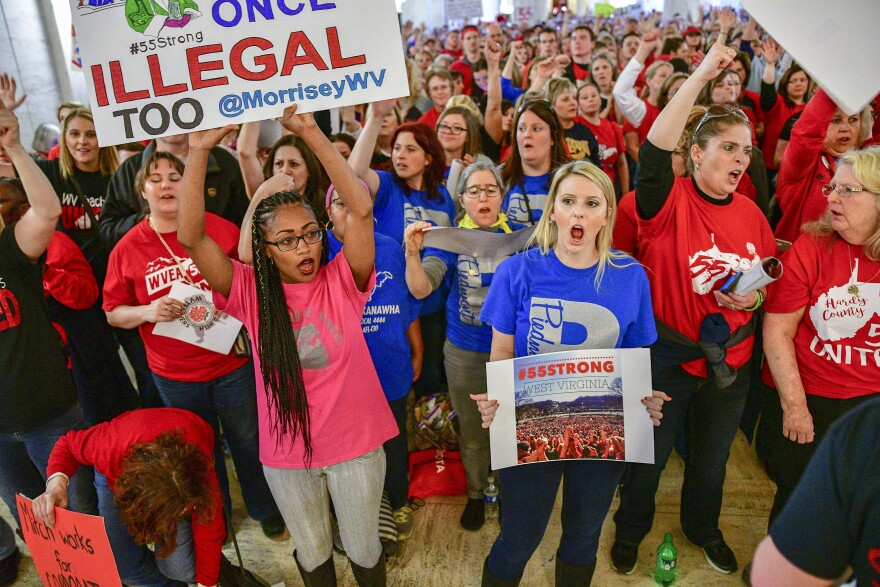 Teachers hold a rally outside the Senate Chambers in the West Virginia Capitol Monday, March. 5, 2018 in Charleston, W.V. Hundreds of teachers from 55 counties were on strike for pay raises and better health benefits.
