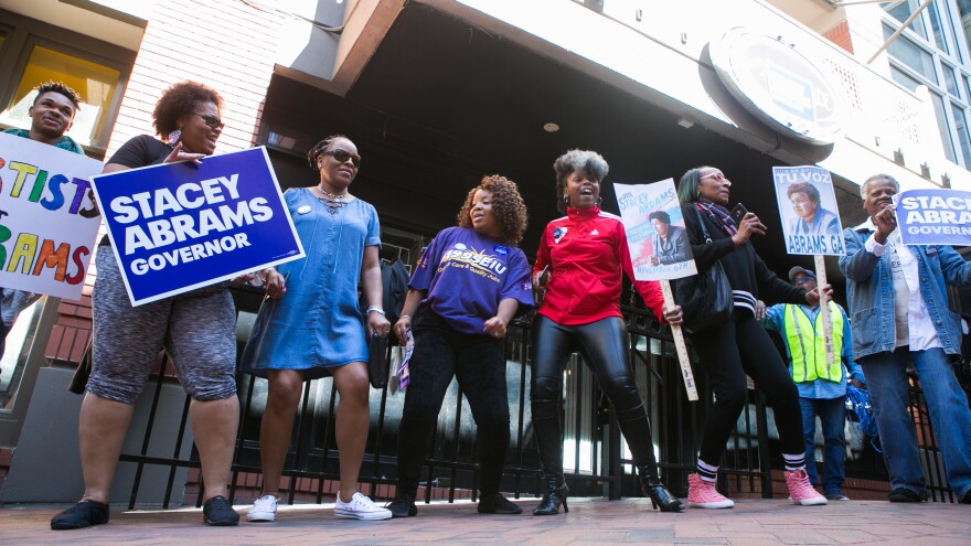"Georgia voters and supporters dance and sing during a ""Souls to The Polls"" march hosted by Democratic Georgia gubernatorial candidate Stacey Abrams in downtown Atlanta on Oct. 28. Alongside artist Common and Ambassador Andrew Young, Abrams marched with voters to a polling station in downtown Atlanta."