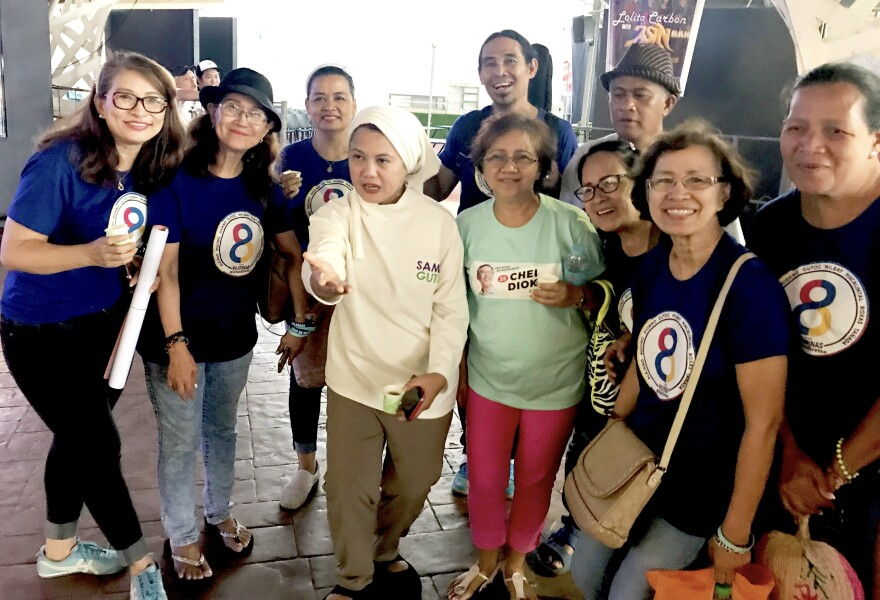 Samira Gutoc (center-left, in white) poses with a group of women who approached her after one of the Otso Diretso campaign<strong> </strong>rallies in Lucena.