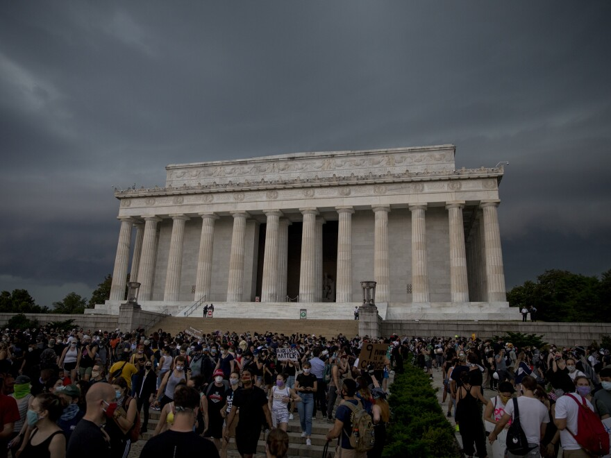 Demonstrators peacefully protest at the Lincoln Memorial as heavy storm clouds move in. Washington, D.C., on Thursday.