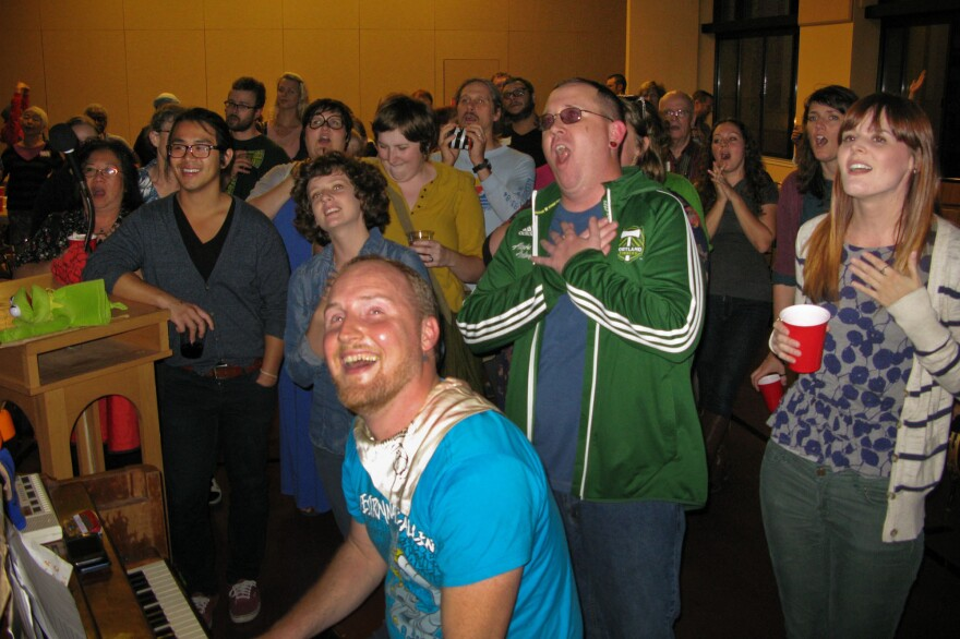 Todd Fadel, at piano, leads singers at a recent gathering of Beer & Hymns at First Christian Church Portland.