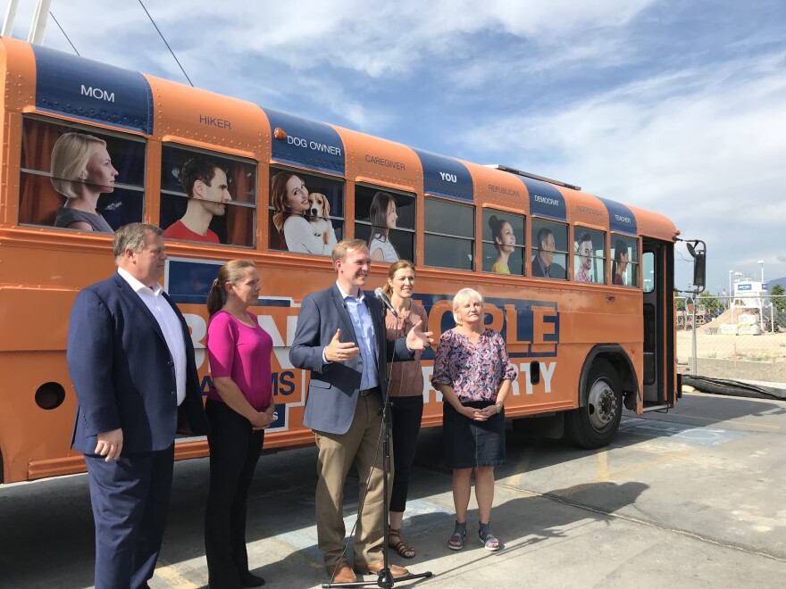Ben McAdams and staff in front of campaign bus.