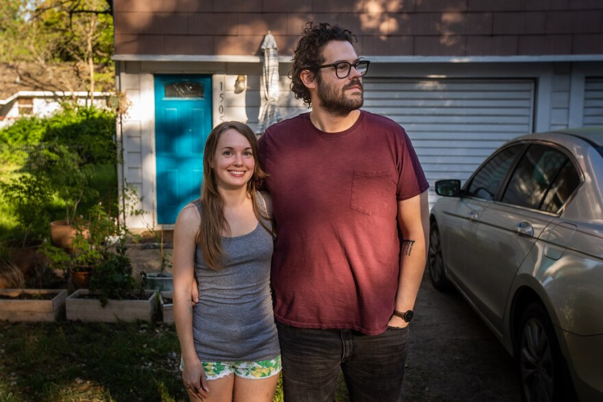 Cherie Little and Steven Kresena stand outside their apartment in South Austin.