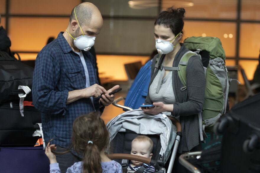 People arrive on a flight from Europe at Logan International Airport in Boston ahead of a travel ban on Friday.