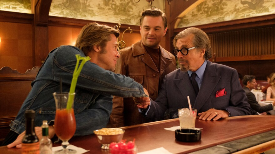 A bloody business: Cliff (Brad Pitt), Rick (Leonardo DiCaprio) and Marvin (Al Pacino) meet at Musso & Frank in <em>Once Upon a Time in ... Hollywood.</em>