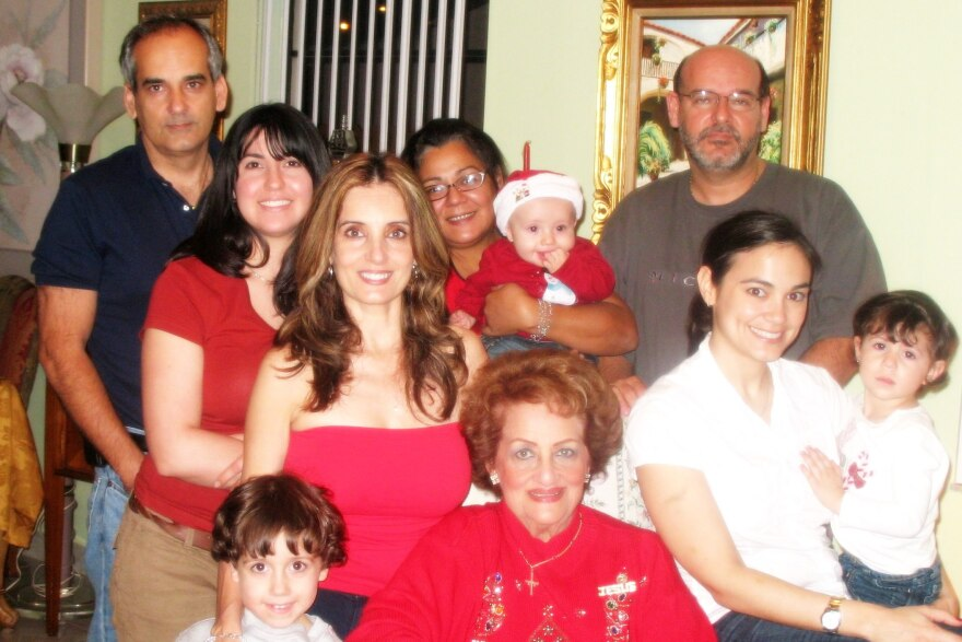Teresita_Garrido_seated_in_red_with_whole_family.jpg