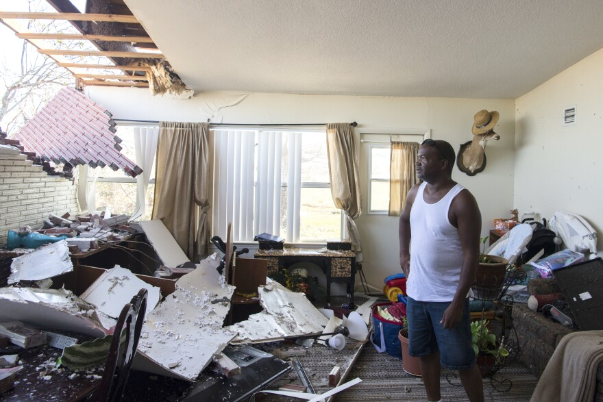 Robert Hill surveys the damage within his living room at Tyndall Air Force Base after Hurricane Michael hit Florida last week.