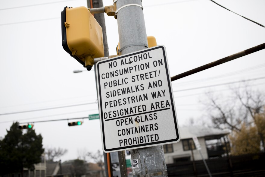 A sign at Cesar Chavez and Chicon streets marks the boundary where public consumption of alcohol is forbidden.