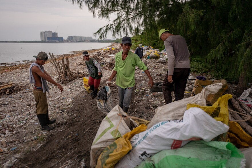 Workers collect and sort garbage on Freedom Island.