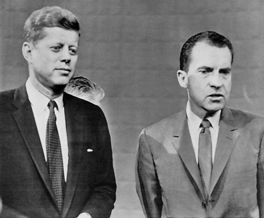 Candidates John F. Kennedy and Richard Nixon pose following their 1960 presidential debate.