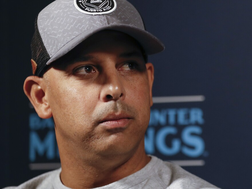 Boston Red Sox manager Alex Cora, pictured in December 2019, announced he is leaving the team in the wake of a Major League Baseball investigation that said he helped develop a  sign-stealing system.