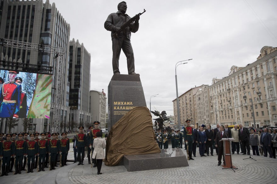 A new monument to Mikhail Kalashnikov, creator of the AK-47, is unveiled during a ceremony Tuesday in Moscow.