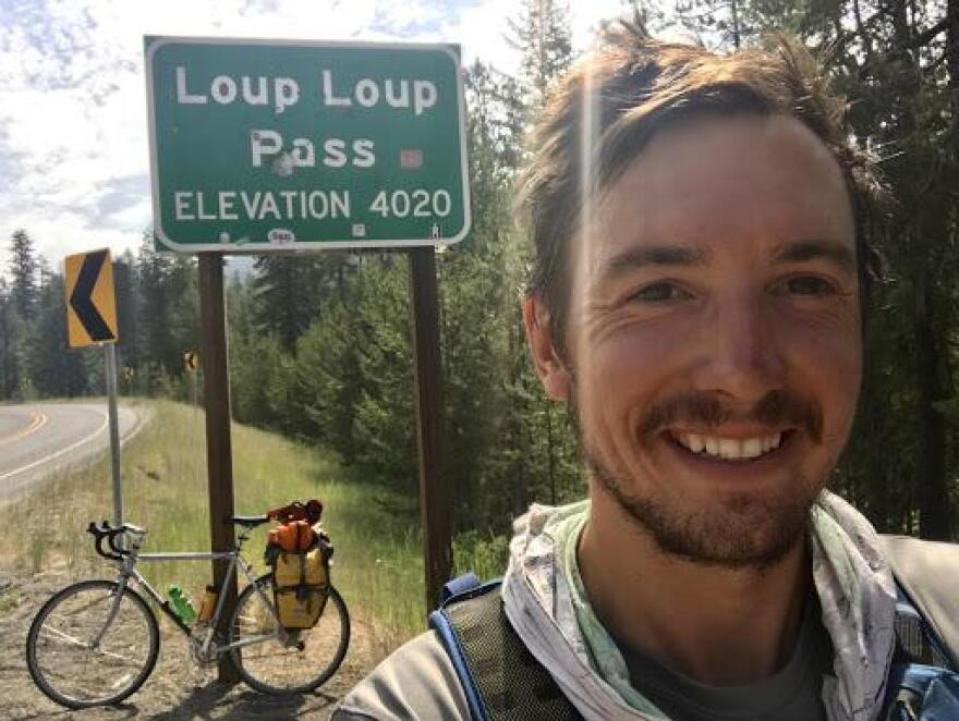 Nate Hegyi, rural reporter for the Mountain West News Bureau, on a cycling trip through Washington State in 2018.