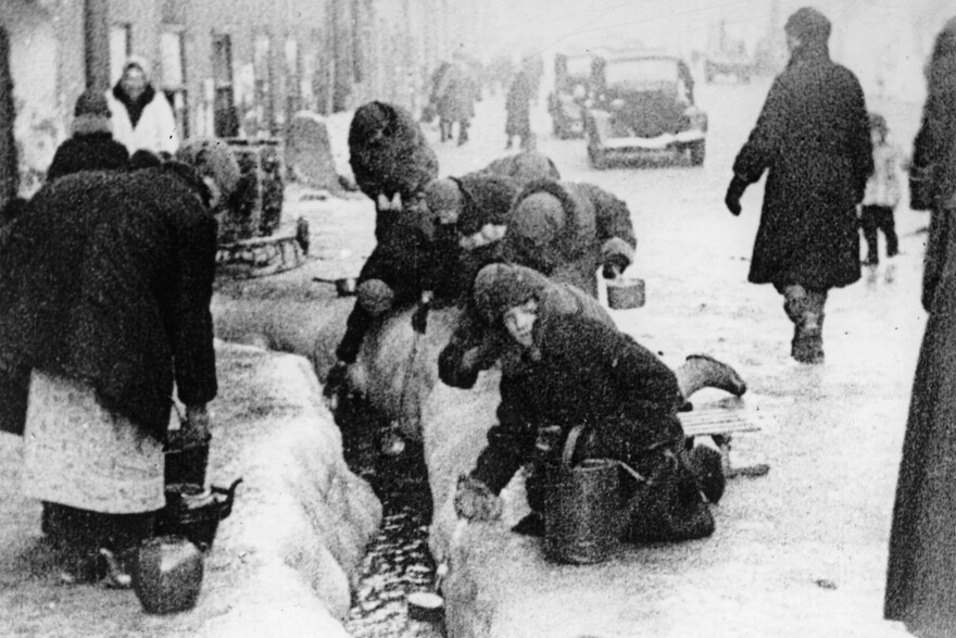 Citizens of Leningrad collect water from a broken main in the winter of 1942, during a blockade of the Russian city by Nazis.