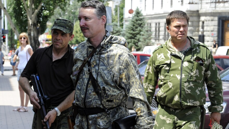 Igor Girkin, a Russian citizen who headed the pro-Russian rebels in eastern Ukraine last year, walks with his bodyguards in the eastern Ukrainian city of Donetsk in July.