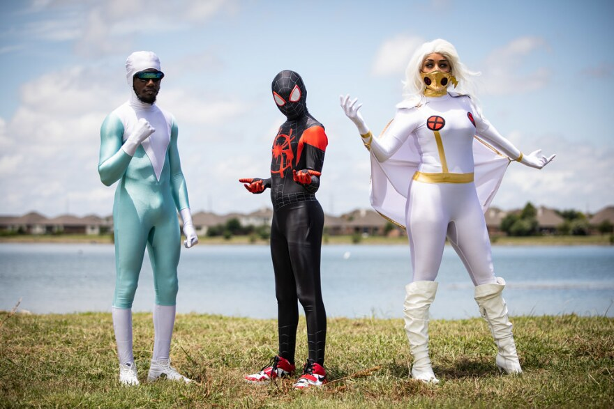"""From left to right, Bradley Spears as Frozone, Hayden Ortiz as Spiderman Miles Morales and Afsaneh Ortiz as Storm. The three, members of the group Black Lives Matter Cosplayers, pose at Lake Pflugerville for """"In Celebration of Freedom: A Pflugerville June"""