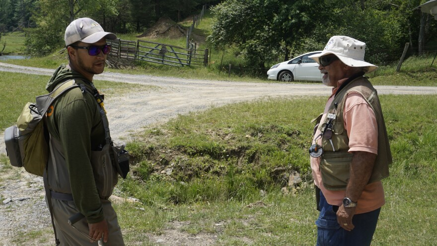 Kyle Chanitz (left) talks with fellow veteran Moir Edwards (right) on a Project Healing Waters trip to Wolf Creek in Bland County, Virginia.