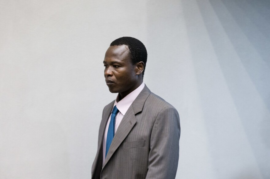 Dominic Ongwen, a senior commander in the Lord's Resistance Army, enters the courtroom of the International Court in The Hague, Netherlands, on Tuesday.