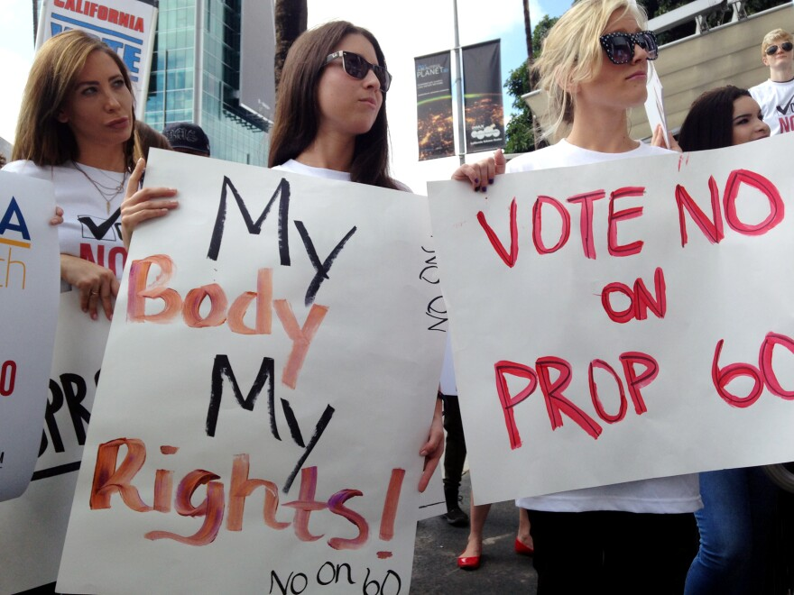 Performers from the adult film industry protest Prop 60 outside the AIDS Healthcare Foundation in Los Angeles.