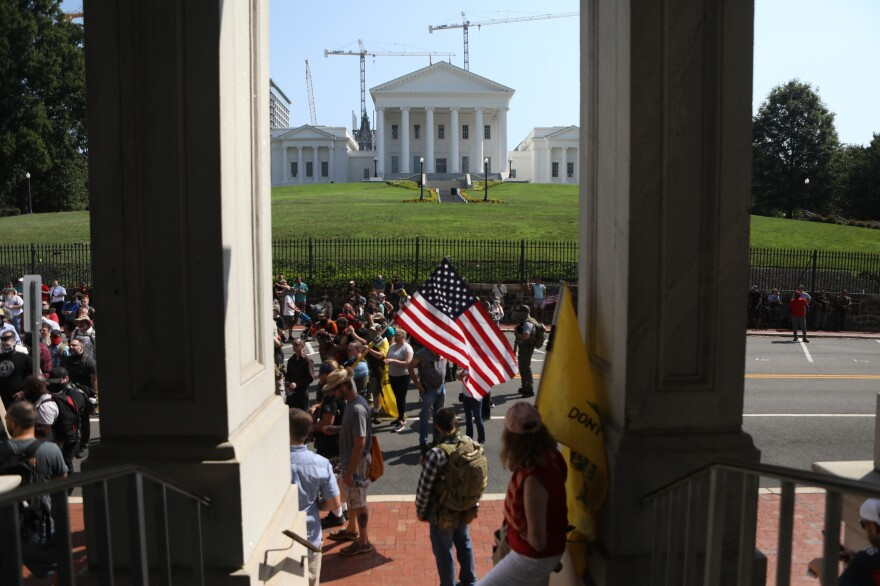 Protesters gather near the Virginia State Capitol during Saturday's gun rights rally.
