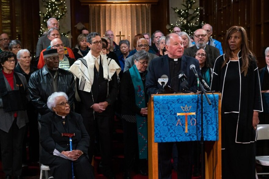 <p>Rev. Dr. W.J. Mark Knutson, chair of Lift Every Voice Oregon, stands with about 40 faith leaders to announce an initiative petition to put new gun laws on the 2020 ballot on December 9th, 2019 in Portland, Oregon</p>